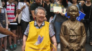 Center of attention is former comfort woman Gil Won-Ok and Comfort Woman Statue